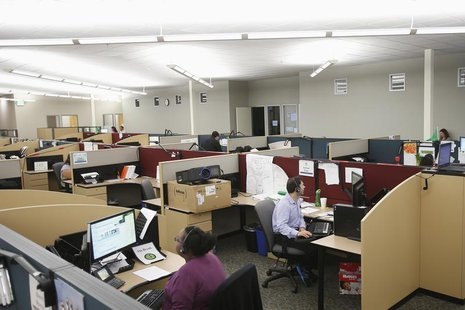 Customer service agents at Covered California's Concord call center work during the opening day of enrollment of the Patient Protection and