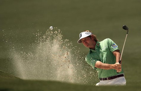 Brandt Snedeker of the U.S. hits from a sand trap on the second hole during third round play in the 2013 Masters golf tournament at the Augu