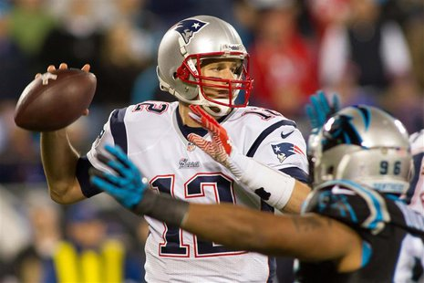 Nov 18, 2013; Charlotte, NC, USA; New England Patriots quarterback Tom Brady (12) throws a pass during the third quarter against the Carolin