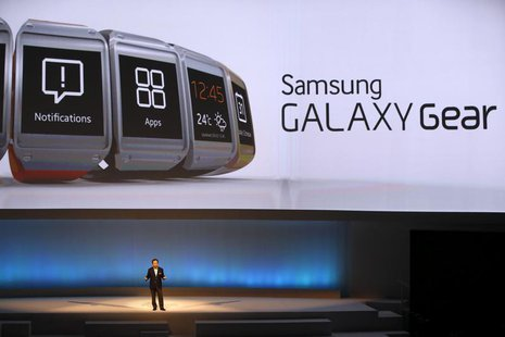 Shin Jong-kyun, President and CEO, head of IT and Mobile Communication division of Samsung presents the Samsung Galaxy Gear smartwatch durin