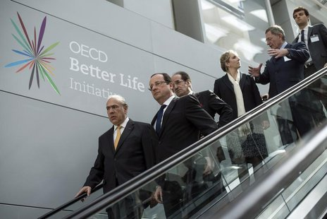 France's President Francois Hollande (2ndL) and Economic Co-operation and Development (OECD) General Secretary Angel Gurria (L) arrive to at