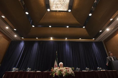 Iran's President Hassan Rouhani (L) speaks during a news conference in New York September 27, 2013. REUTERS/Adrees Latif