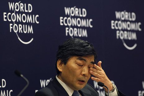 Naoyuki Shinohara, deputy managing director of the International Monetary Fund (IMF), wipes his eye during an interactive session of Rethink