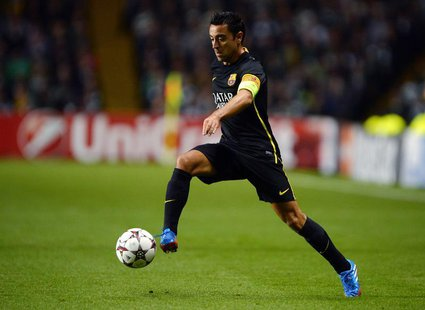 Barcelona's Xavi Hernandez runs with the ball during their Champions League soccer match against Celtic at Celtic Park in Glasgow, October 1