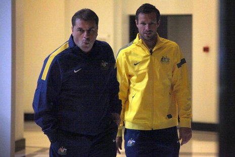 Captain of the Australian soccer team Lucas Neill (R) walks with new team coach Ange Postecoglou to a media conference in Sydney November 18