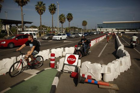 Cars wait in line to enter to Spain at its border with the British territory of Gibraltar, before the arrival of European Commission officia