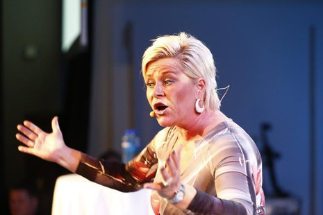 Siv Jensen, leader of Norway's Fremskrittspartiet (Progress party), speaks to party members while waiting for the result of the general elec