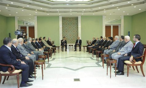 Syria's President Bashar al-Assad (center L) meets members of the General Secretariat of the Arab Parties' General Conference in Damascus No