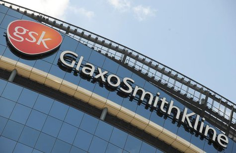Signage is pictured on the company headquarters of GlaxoSmithKline in west London July 21, 2008. GlaxoSmithKline announce their half yearly