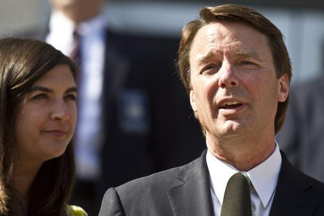 Former U.S. Senator John Edwards makes a statement with his daughter, Cate Edwards (R) after the jury reached a verdict at the federal court