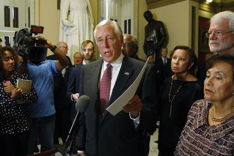 U.S. House Minority Whip Steny Hoyer (D-MD) holds a copy of the Democratic legislation as he speaks to the media at the U.S. Capitol in Wash