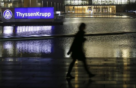 A woman walks past the of Germany's top steelmaker ThyssenKrupp headquarters in Essen November 18, 2013. REUTERS/Ina Fassbender
