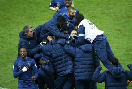 France's soccer team players celebrate after Ukraine's Oleg Guslev (unseen) scored an own goal during their 2014 World Cup qualifying second