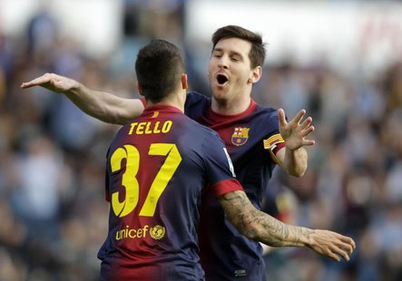 Barcelona's Cristian Tello (L) celebrates his goal against Celta Vigo with teammate Lionel Messi during their Spanish First Division soccer