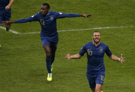 France's Karim Benzema celebrates with teammates after scoring the second goal for the team during their 2014 World Cup qualifying second le