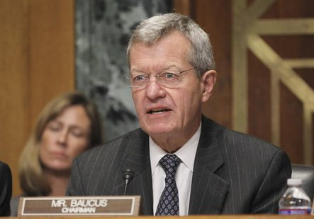 U.S. Senate Finance Committee Chairman Max Baucus questions Health and Human Services Secretary Kathleen Sebelius during a Finance Committee