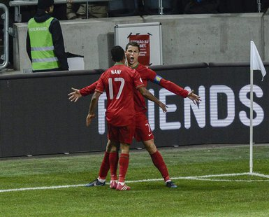 Portugal's Cristiano Ronaldo celebrates his goal against Sweden, with teammate Nani, during the second leg of their 2014 World Cup qualifyin