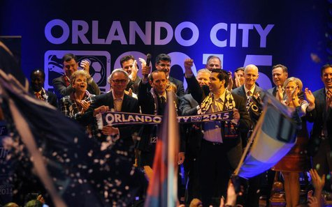 MLS Orlando City SC team president Phil Rawlins (left), MLS commissioner Don Garber, (center) and Orlando City SC Owner Flavio Augusto Da Si