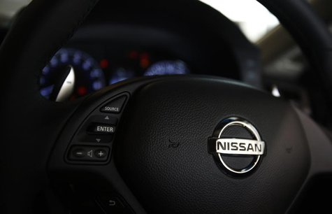 A logo of Nissan Motor Co is seen on a steering wheel of a car at the company's showroom in Yokohama, south of Tokyo November 1, 2013. REUTE