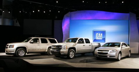General Motors' Chevrolet hybrid vehicles including the Chevrolet Tahoe Hybrid (L), the Chevy Silverado Hybrid (C), and the Chevy Malibu Hyb