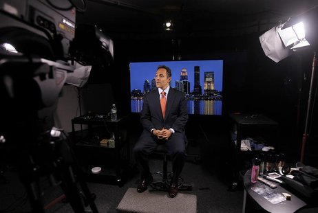 Republican senate candidate Matt Bevin prepares for an interview with a Fox reporter in Louisville, Kentucky, October 23, 2013. REUTERS/John