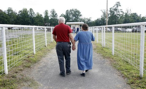 A couple leaves the Remote Area Medical (RAM) health clinic at the Wise County Fairgrounds in Wise, Virginia July 24, 2009. REUTERS/Shannon