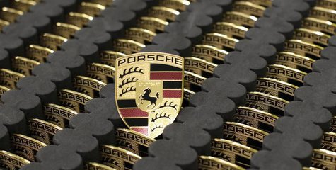 Car emblems for the new Porsche 918-Spyder are placed in a box at the production line of the German car manufacturer's plant in Stuttgart-Zu