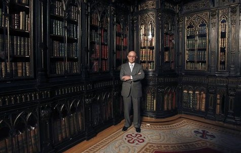 Spain's Treasury Minister Cristobal Montoro poses for pictures at the Senate Library before an interview with Reuters in Madrid November 19,