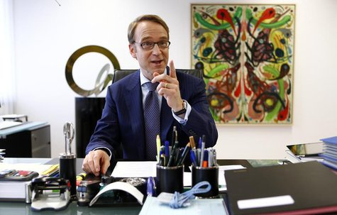 Germany's federal reserve Bundesbank President Jens Weidmann poses in his office in the Bundesbank headquarters during a photo shoot with Re