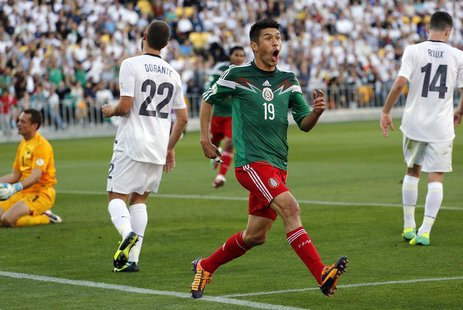 Mexico's Oribe Peralta celebrates after scoring a goal as New Zealand's Glen Moss, Andrew Durante and Storm Roux (L-R) react during their 20