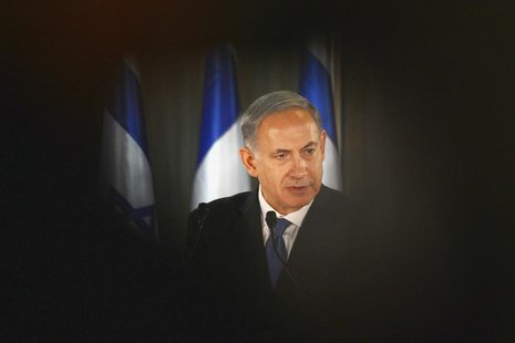 Israel Prime Minister Benjamin Netanyahu speaks during a joint news conference with French President Francois Hollande (not pictured) at his