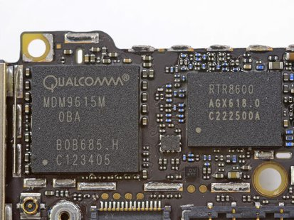 Handout image released by iFixit.com shows the Qualcomm MDM9615M chip on a board of a new iPhone 5 in Melbourne, Australia September 21, 201
