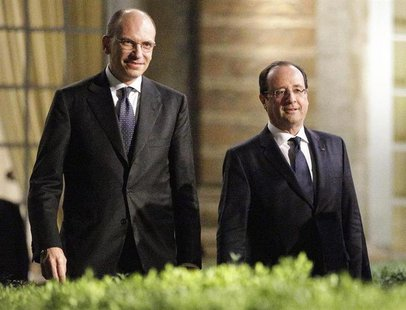 Italian Prime Minister Enrico Letta (L) and French President Francois Hollande walk during a break in their meeting at Villa Madama in Rome