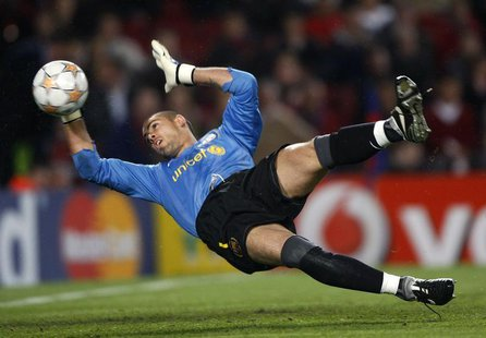 Barcelona's goalkeeper Victor Valdes blocks a ball against Schalke 04 during their Champions League quarter-final second leg soccer match at