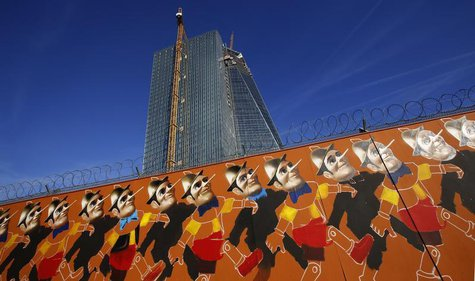 A graffiti is seen at the fence surrounding the construction site of the new headquarters of the European Central Bank (ECB) in Frankfurt, O