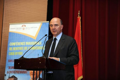 "French Finance Minister Pierre Moscovici speaks at a conference on the theme ""Youth and Entrepreneurship"" at Cadi Ayyad University in Marrak"