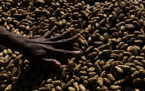 A woman arranges peanuts at the main markets in Honiara September 14, 2012. REUTERS/Daniel Munoz
