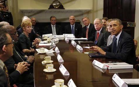 U.S. President Barack Obama meets with health insurance chief executives at the White House in Washington November 15, 2013. REUTERS/Kevin L