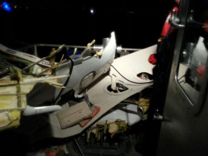 The wreckage of a plane that crashed into the Atlantic Ocean is brought aboard a U.S. Coast Guard boat off the coast of Fort Lauderdale, Flo