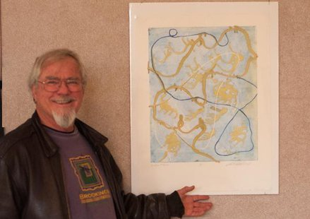 "Bob Semrad of Brookings poses by ""Golden Oldies,"" a print he created in which the blue, gold and white strings represent his interconnected journey through life as a pilot, a forester and a pastor/chaplain. The print, as well as 29 other items, will be auctioned off Saturday at DVAGI's 10th annual fundraiser. SDSU.edu"