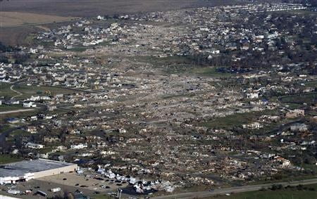 An aerial view shows the path of destruction caused by a tornado that touched down in Washington, Illinois, November 18, 2013. CREDIT: REUTERS/JIM YOUNG