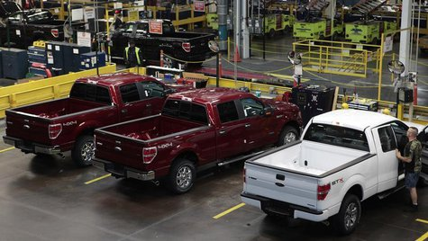 2014 Ford F-150 pick-up trucks are seen in quality control at the Ford Motor Dearborn Truck Plant in Dearborn, Michigan September 16, 2013.