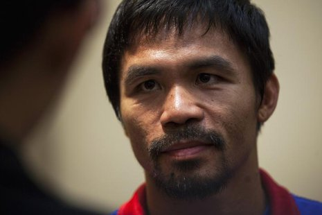 Boxer Manny Pacquiao of the Philippines looks on during a news conference at the Venetian Macao hotel in Macau November 19, 2013. REUTERS/Ty