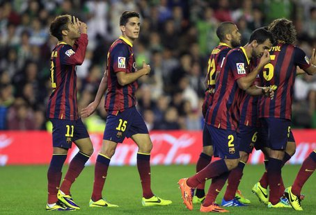Barcelona's Neymar (L) celebrates with teammates after scoring against Real Betis during their Spanish First Division soccer match at Benito