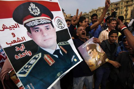 Supporters of Egypt's army chief General Abdel Fattah al-Sisi hold up a poster of Sisi at Tahrir square in downtown Cairo, November 19, 2013