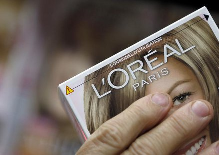 A customer holds a L'Oreal cosmetics group product in an supermarket in Lanton, Southwestern France, August 30, 2013. REUTERS/Regis Duvignau