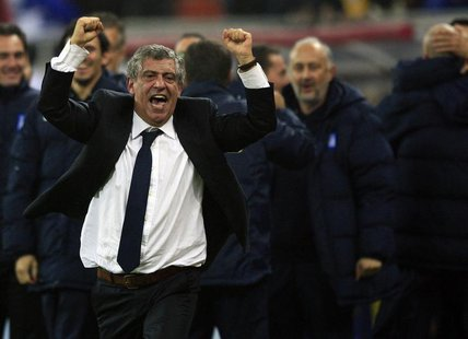 Greece's head coach Fernando Santos celebrates defeating Romania during their 2014 World Cup qualifying soccer match in Bucharest November 1