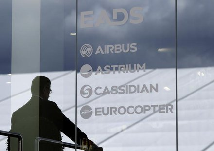 A visitor stands at the EADS booth during the ILA Berlin Air Show in Selchow near Schoenefeld south of Berlin, September 13, 2012. REUTERS/T