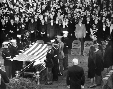 Mourners look on during the burial and folding of the flag ceremony for former U.S. President John F. Kennedy at Arlington National Cemetery