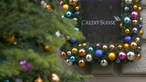 Christmas decoration is placed around the logo of Swiss bank Credit Suisse beside the entrance to its headquarters in Zurich November 21, 20